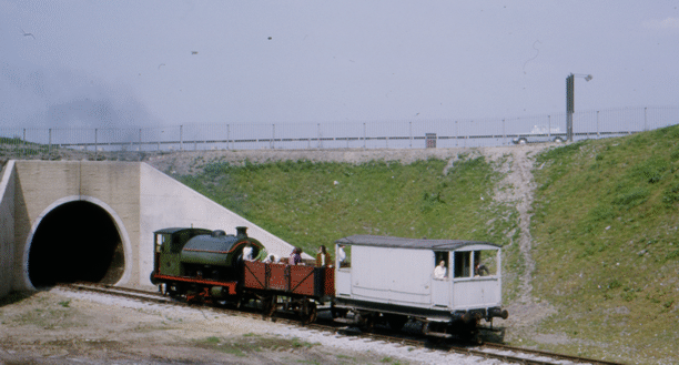 No. 6  on a passenger train, emerging from the tunnel.
