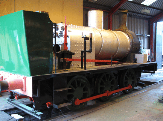 loco in workshop with the boiler in the frames