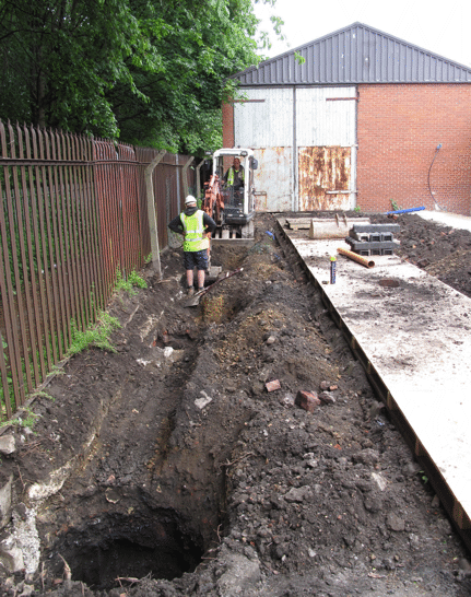 excavating foundation trench