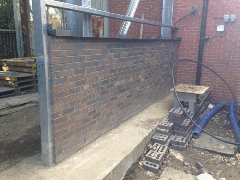 one section of brickwork almost complete